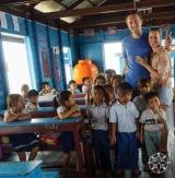 <h5>Josh and Krissy making friends at Chong Khneas floating village, Tonle Sap Lake, Siem Reap, Cambodia</h5>