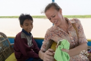 <h5>Krissy making friend on the Siem Reap River, Cambodia</h5>